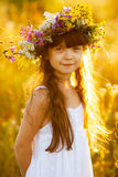 Happy cute girl wearing a wreath of flowers Royalty Free Stock Image