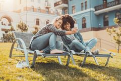 Female couple outdoors taking selfie on the smartphone royalty free stock photos