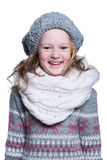 Happy cute kid posing in the studio isolated on white background. Wearing winter clothes. Knitted woolen sweater, scarf, hat Stock Image