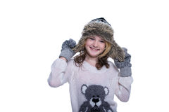 Happy cute kid posing in the studio isolated on white background. Wearing winter clothes. Knitted woolen sweater, scarf, hat Royalty Free Stock Photos