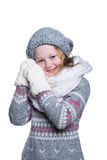 Happy cute kid posing in the studio isolated on white background. Wearing winter clothes. Knitted woolen sweater, scarf, hat. Royalty Free Stock Photo