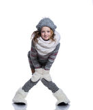 Happy cute kid posing in the studio isolated on white background. Wearing winter clothes. Knitted woolen sweater, scarf, hat Stock Images