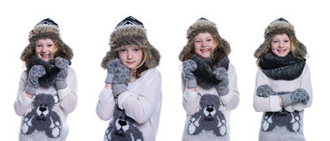 Happy cute kid posing in the studio. Wearing winter clothes. Knitted woolen sweater and mittens. Ear flaps fur cap. Isolated on white background. Composite Stock Images