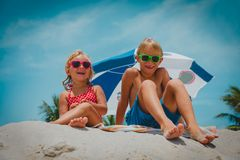 Happy cute kids- boy and girl play on beach. Happy cute kids- boy and girl- play on tropical beach royalty free stock photography