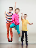 Happy cute kids little girl and boys jumping. Happy joyful sweet cute kids little girl and boys jumping. Childhood happiness Stock Images