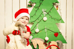 Happy cute little baby on Christmas Stock Photos