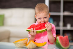 Happy cute little boy eating watermelon Royalty Free Stock Images