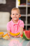 Happy cute little boy eating watermelon Royalty Free Stock Photo