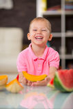 Happy cute little boy eating watermelon Stock Image