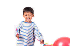Happy cute little boy play  red balloon Stock Photos