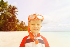 Happy cute little boy snorkel at beach Stock Photos