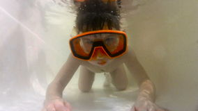 Happy cute little boy underwater stock video