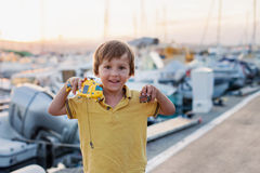 Happy cute little child, boy, playing with helicopter on a port Stock Photography