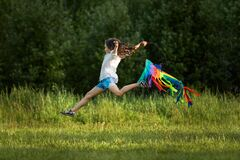 Free Happy Cute Little Child Girl Launches Kite Royalty Free Stock Photography - 187353687