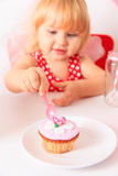 Happy cute little girl at birthday party Stock Photos