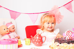 Happy cute little girl at birthday party Royalty Free Stock Images