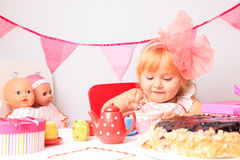Happy cute little girl at birthday party Stock Image