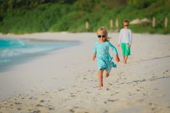 Happy cute little girl and boy on beach vacation royalty free stock photos
