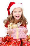 Happy cute little girl with christmas gift boxes Royalty Free Stock Photos