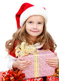 Happy cute little girl with christmas gift boxes Stock Photos