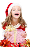 Happy cute little girl with christmas gift Royalty Free Stock Photos