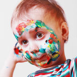 Happy cute little girl with colorful painted face Royalty Free Stock Image