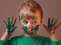 Happy cute little girl with colorful painted hands Royalty Free Stock Photos