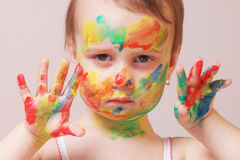 Happy cute little girl with colorful painted hands Stock Photo