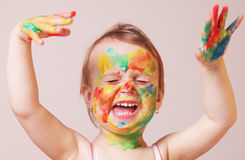 Happy cute little girl with colorful painted hands Royalty Free Stock Photo