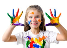 Happy cute little girl with colorful painted hands Royalty Free Stock Image