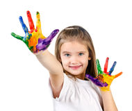 Happy cute little girl with colorful painted hands. Isolated on a white education concept royalty free stock images