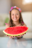 Happy cute little girl eating watermelon Stock Photography