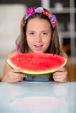 Happy cute little girl eating watermelon Royalty Free Stock Image