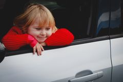 Happy cute little girl enjoy travel by car. Family travel royalty free stock photos