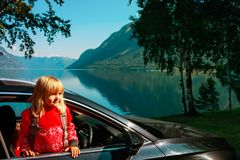 Happy little girl enjoy travel by car in nature, family transport. Happy cute little girl enjoy travel by car in nature, family transport royalty free stock photos