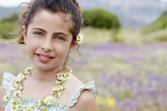 Happy Cute Little Girl In Flower Necklace Stock Photo