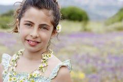 Happy Cute Little Girl In Flower Necklace Stock Photo