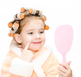 Happy cute little girl in hair curlers with mirror Royalty Free Stock Photo
