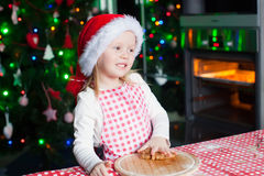 Happy cute little girl in the kitchen baking Stock Photography