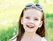 Happy cute little girl on the meadow Royalty Free Stock Photos