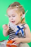 Happy cute little girl with piggy bank stock image