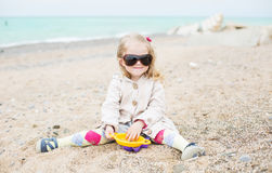 Happy cute little girl playing Stock Images