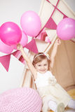 Happy cute little girl rejoicing at birthday party Stock Photo