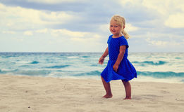 Happy cute little girl run on beach Royalty Free Stock Images