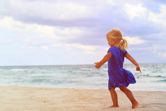 Happy cute little girl run on beach Stock Images