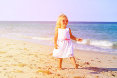 Happy cute little girl running on beach Stock Image