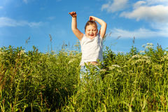 Smiling little girl running Stock Photos