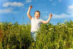 Smiling little girl running Stock Photo