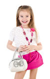 Happy cute little girl in skirt with bag and beads isolated Royalty Free Stock Photo