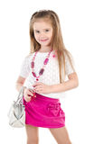 Happy cute little girl in skirt with bag and beads Royalty Free Stock Photo